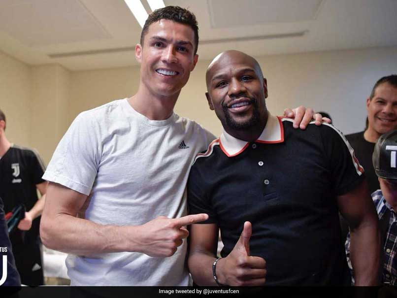 Champions Celebrating With A Champion: Cristiano Ronaldo Celebrates Italian Super Cup Victory With Floyd Mayweather