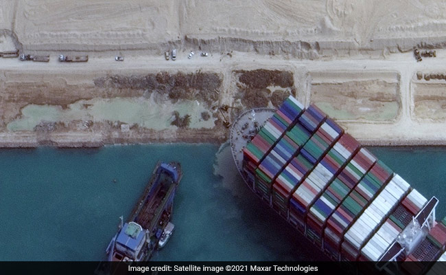 Diggers, Dredgers Struggle To Free Ship Blocking Suez Canal