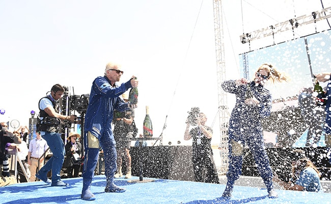 Party Time: Champagne And Celebrities Mark Richard Branson's Space Flight