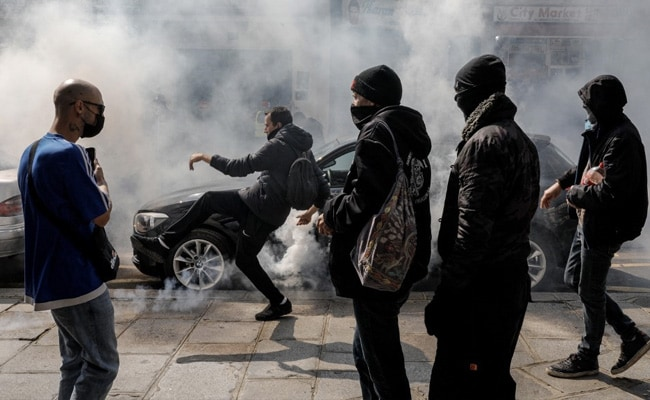 French Police Fire Tear Gas As Thousands Protest Against Covid Rules