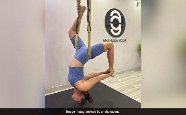 Can You Guess The Actress Doing Aerial Yoga In This Pic?