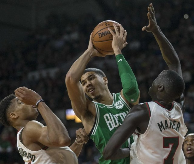 Boston Celtics Jayson Tatum Looks To Pass The Ball After Being Stopped By Milwaukee Bucks