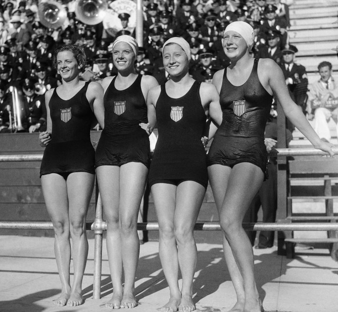 Mrs. Carroll (second from left) posed with her relay team with Josephine McKim (left), Eleanor Saville-Garatti, and Helene Madison (right).