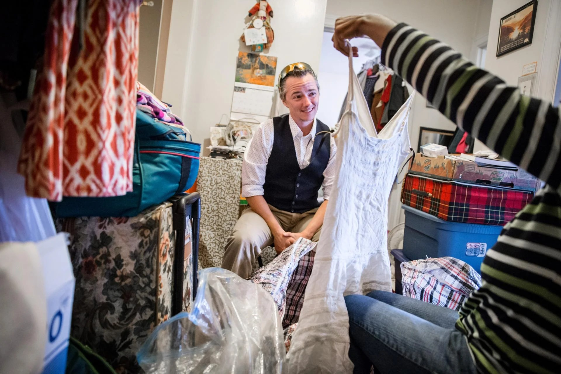 10/13/2016 MATTAPAN, MA Jesse Edsell-Vetter (cq), Hoarding Intervention Program Manager, helps his client sort through clothing during a site visit at a home in Mattapan. (Aram Boghosian for The Boston Globe)