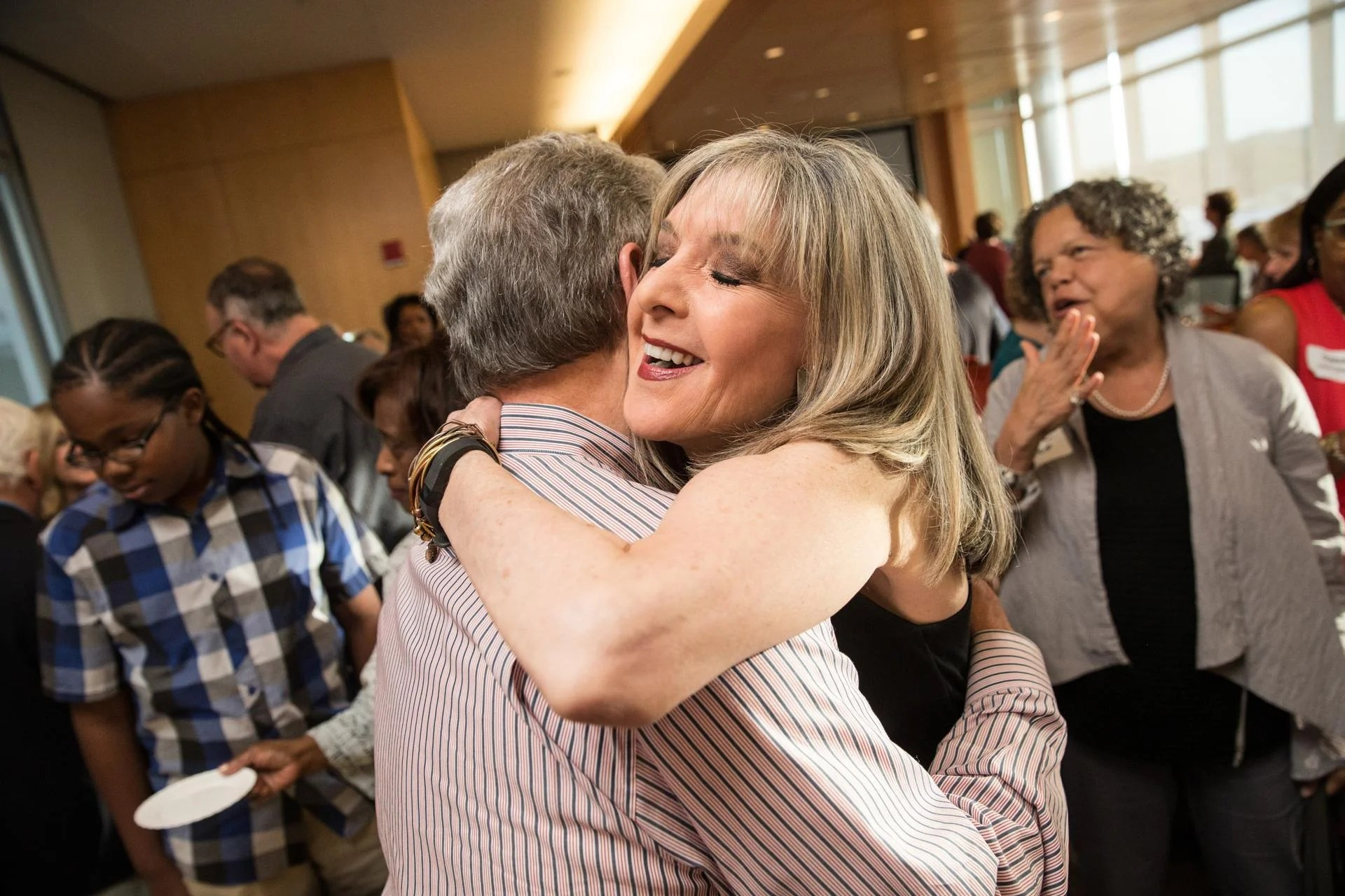 06/14/2017 BOSTON, MA Hank Phillippi Ryan (cq) hugs Mike Lawrence (cq) during a cocktail party at WGBH studios. (Aram Boghosian for The Boston Globe)