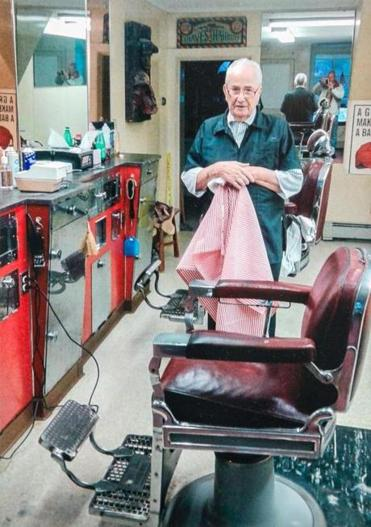 At 90 barber Walter Julian of Rockport is cutting out