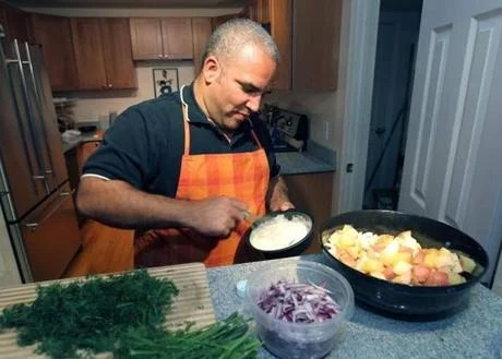 Derek Neilson makes potato salad for Community Cooks.