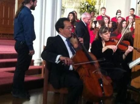 Cellist Yo Yo Ma warmed up before the service at the Cathedral of the Holy Cross.