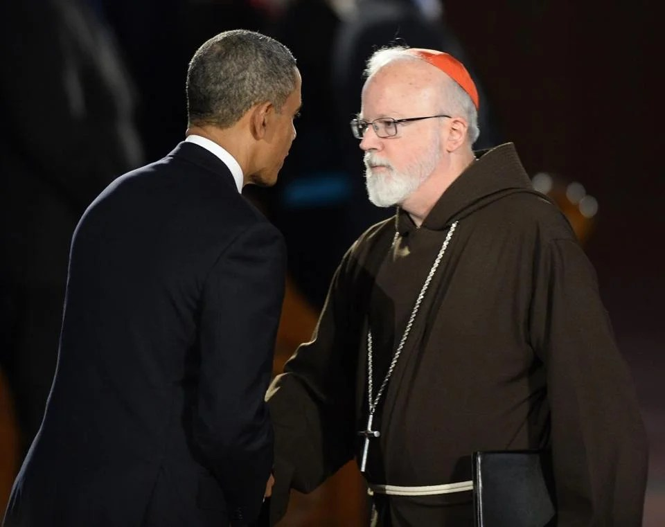 Boston Cardinal Sean O'Malley and President Barack Obama shook hands at the end of Thursday's interfaith service.