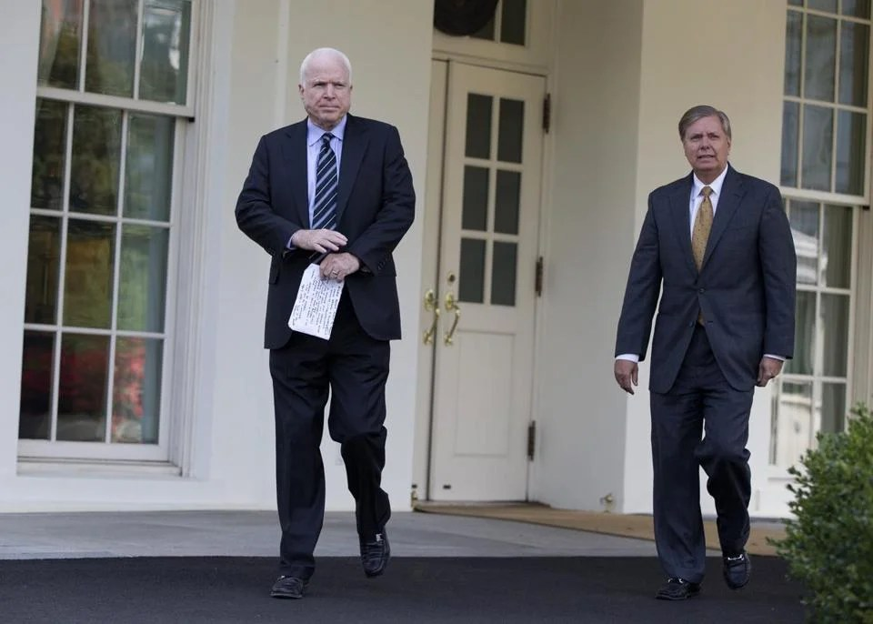 Sen. John McCain, left, and Sen. Lindsey Graham departed the White House following a meeting with President Obama.