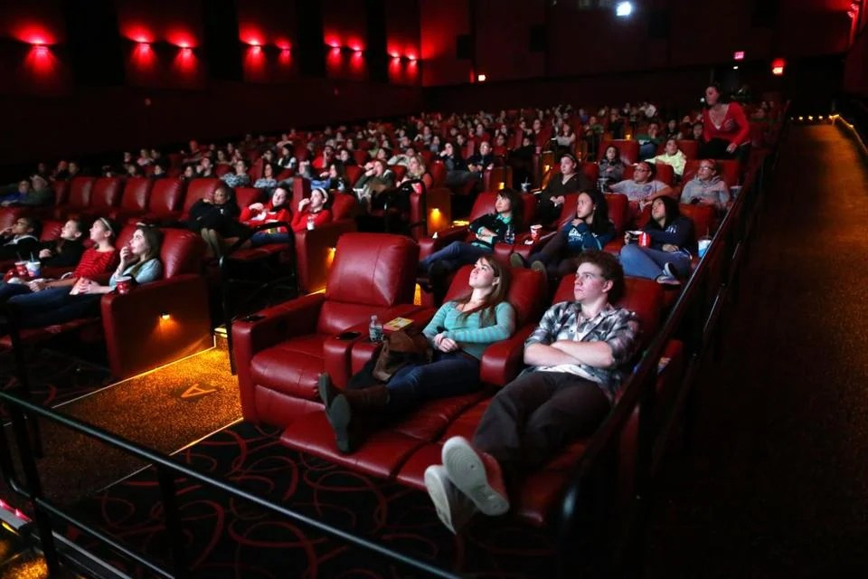 movie theaters with lounge chairs chair to twin bed luxe life a sampling of the mounting amenities theater chains kerri donaghue left and jack hennessy right relax in all powered recliner