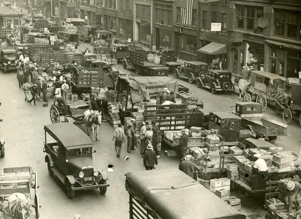 October 5 1933 / fromthearchive / Globe Archive photo / Commerce at the farmer's market scene at the foot of State street. Farmers could sell their produce in the public market place from midnight until 11 a.m. under a law passed by the Massachusetts Legislature in 1859.<br /><br />