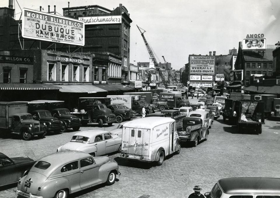 1953 / fromthearchive / Globe Staff photo by Harry Holbrook / A crowded market district. While most of the advertising was for businesses long gone from the Boston scene, a Union Oyster House truck be seen in the middle left. Opened in 1826, it is Boston's oldest restaurant still in business today.<br /><br />