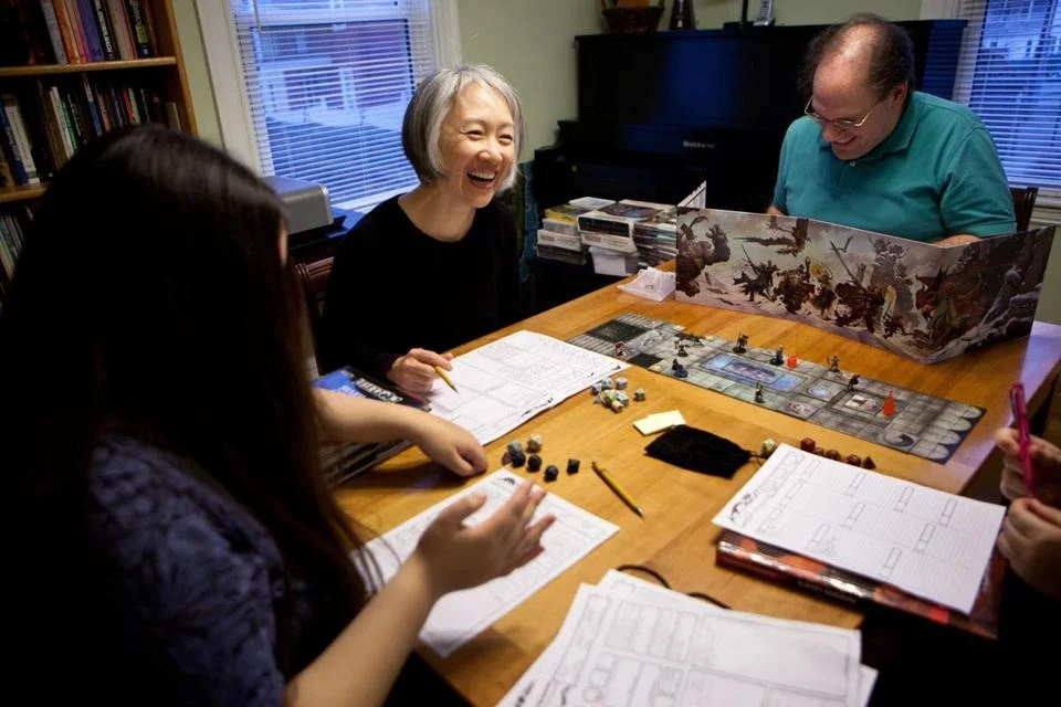 From left: Sophia, Jung, and Charles Starrett play D&D at home.