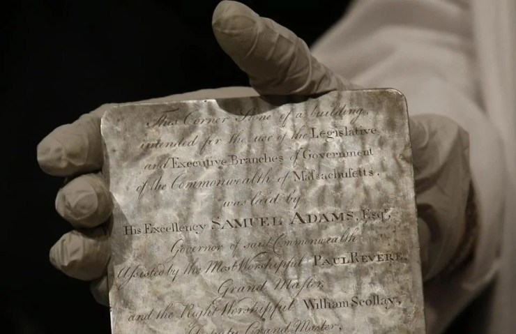 Pam Hatchfield held a silver plaque that was inside the time capsule.