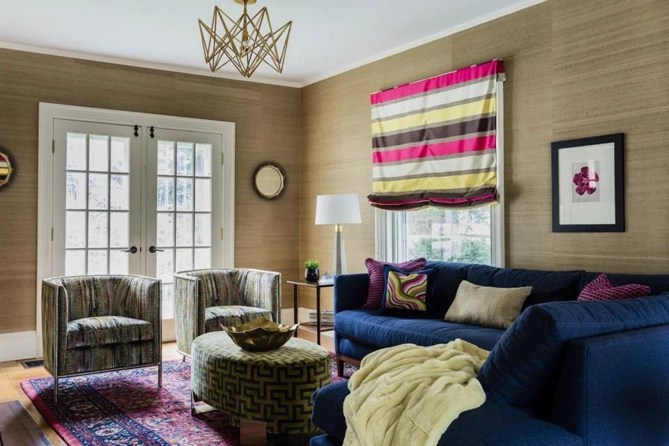 living room boston bench seat what makes this twice as nice the globe by introducing bright colors different textiles and a sectional sofa interior designer ana