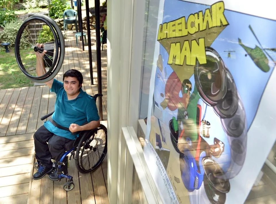 wheelchair man dark teal chair covers tells a real life superhero story the boston globe