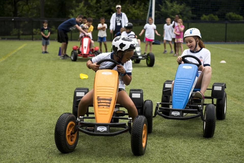Pedal car riding at Beaver Summer Camp, held at Beaver Country Day School in Chestnut Hill.