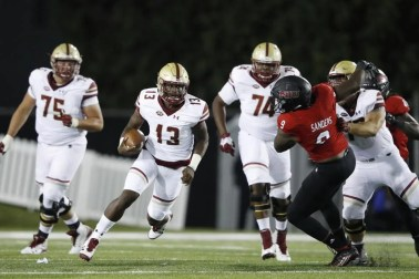 BC freshman Anthony Brown, who threw for 191 yards and two TDs, runs for a 9-yard gain, his longest of the night.