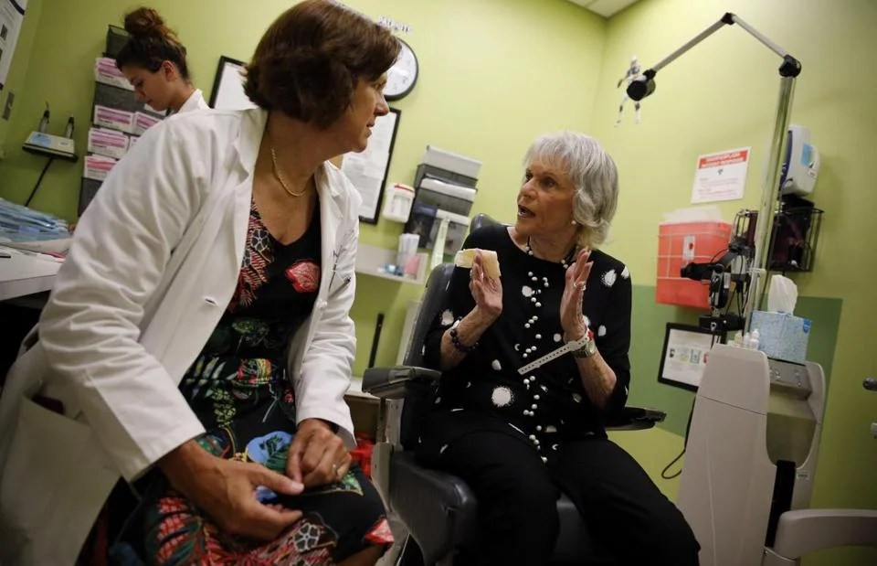 Dr. Joan Miller spoke with Althea Lank before treating her for age-related macular degeneration at Mass. Eye and Ear in Boston on Sept. 6.