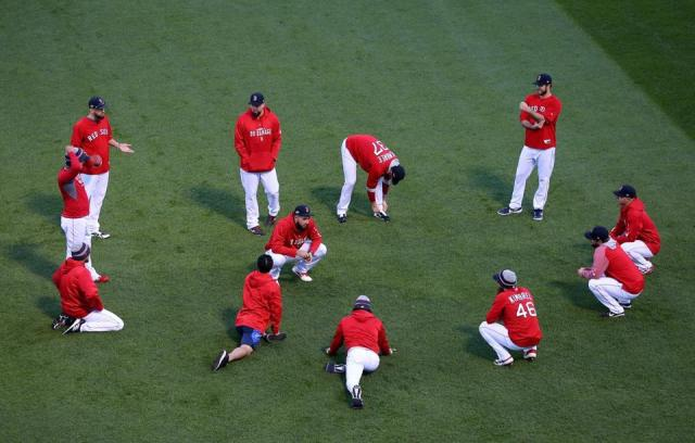 Red Sox players warm up before Game 1.