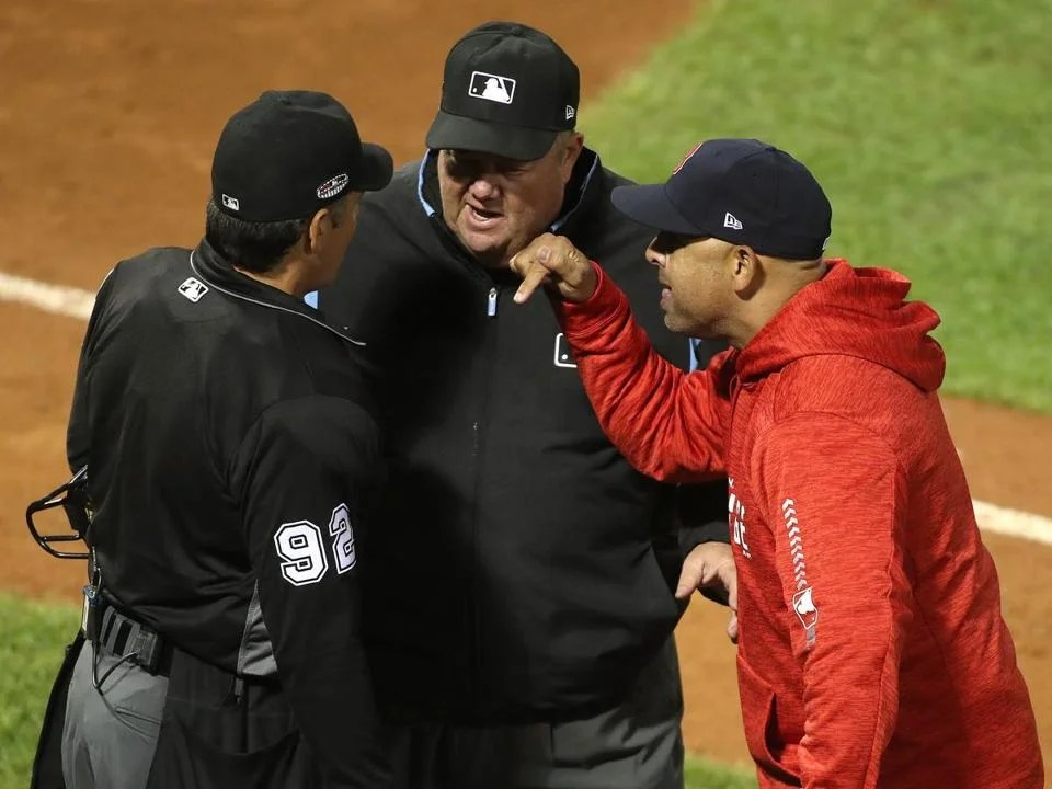 Boston, MA 10/13/18: Red Sox Manager Alex Cora quarrels with the referees at the end of the fifth innings. Boston Red Sox hosted the Houston Astros in Game One by ALCS at Fenway Park Saturday, October 13, 2018. (
