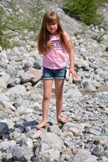 Model Walking Barefoot On Rocks