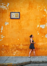 Free Images : person, woman, sidewalk, wall, sign, orange