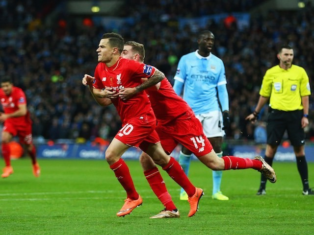 Philippe Coutinho and Jordan Henderson celebrate during the League Cup final between Liverpool and Manchester City on February 28, 2016