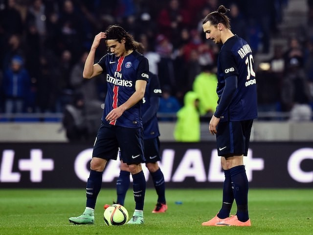 Zlatan Ibrahimovic and Edinson Cavani look downbeat during the Ligue 1 game between Lyon and Paris Saint-Germain on February 28, 2016