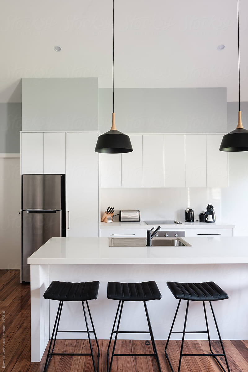 Contemporary Kitchen Interior With Island Bench And Bar Stools By Rowena Naylor Stocksy United