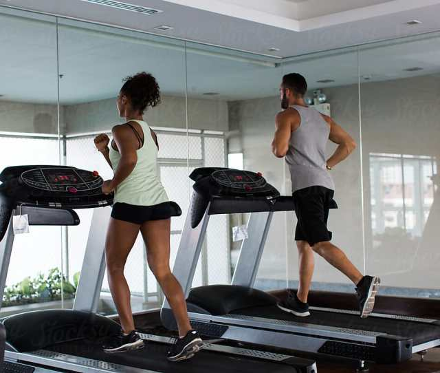 Two People Running On A Treadmill
