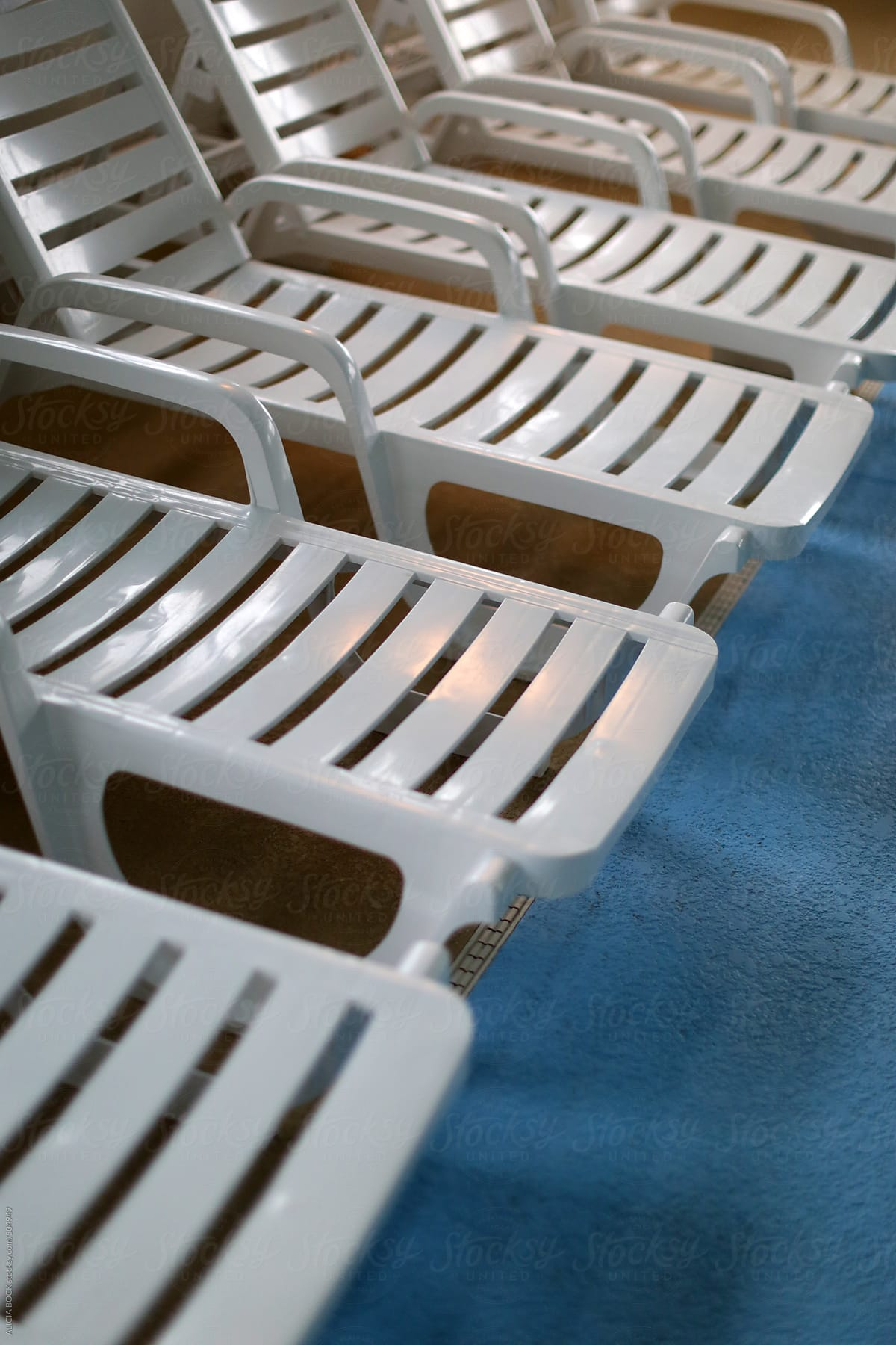 Pool Deck Chairs Stock Photo A Row Of Lounge Chairs In A Row On A Swimming Pool Deck