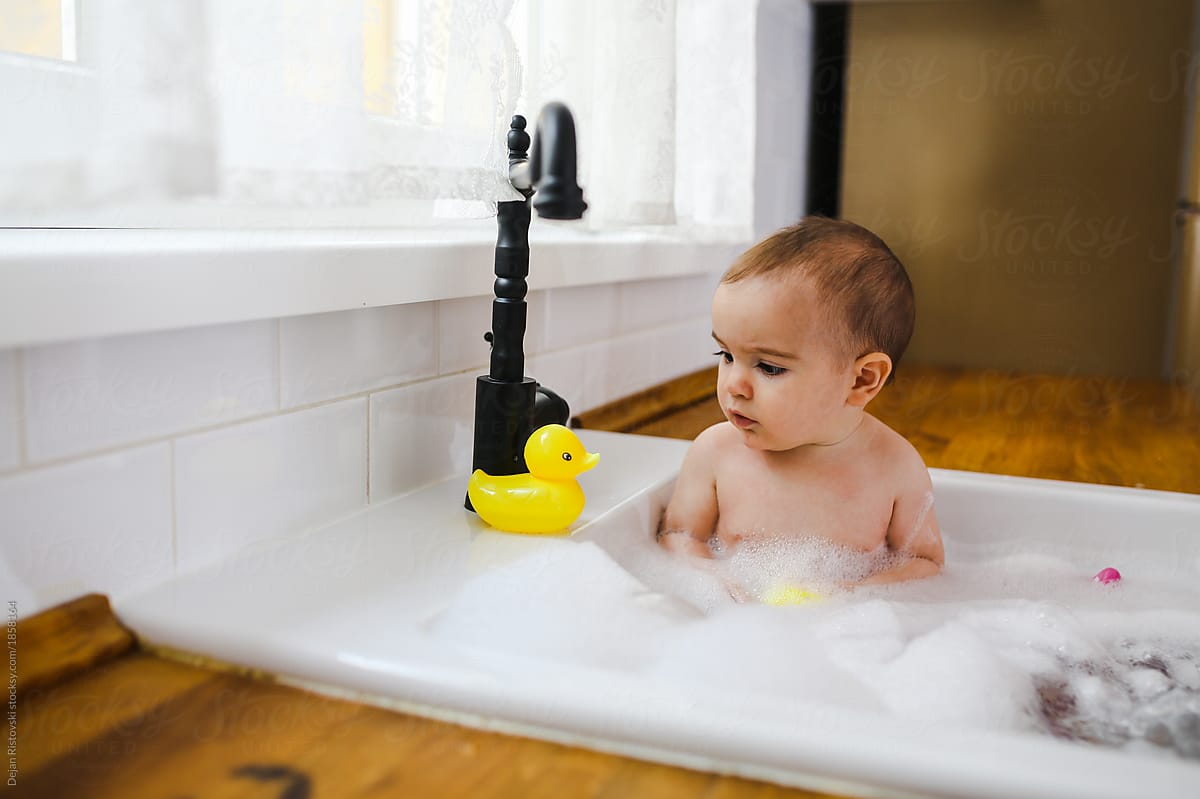 kitchen sink baby bath tub high end faucets brands having a in the stocksy united by dejan ristovski for