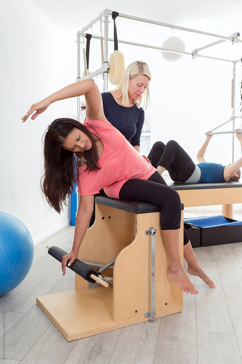 Chair Exercise Stock Photo Pilates Exercise On The Wunda Chair With Instructor And Student