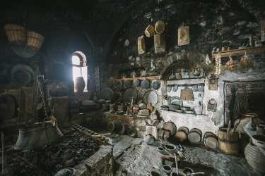 old rural medieval kitchen in ancient monastery by Akela from alp to alp Kitchen Medieval Stocksy United