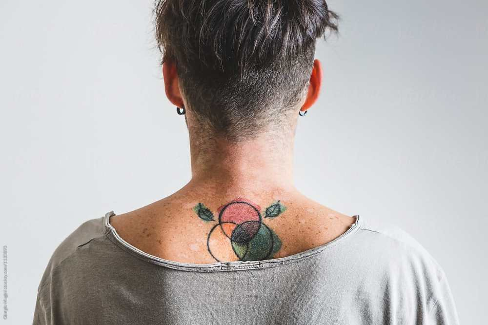 medium resolution of young man with color diagram tattoo under his neck by giorgio magini for stocksy united