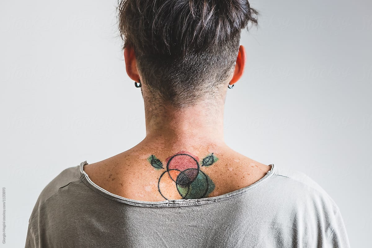 hight resolution of young man with color diagram tattoo under his neck by giorgio magini for stocksy united