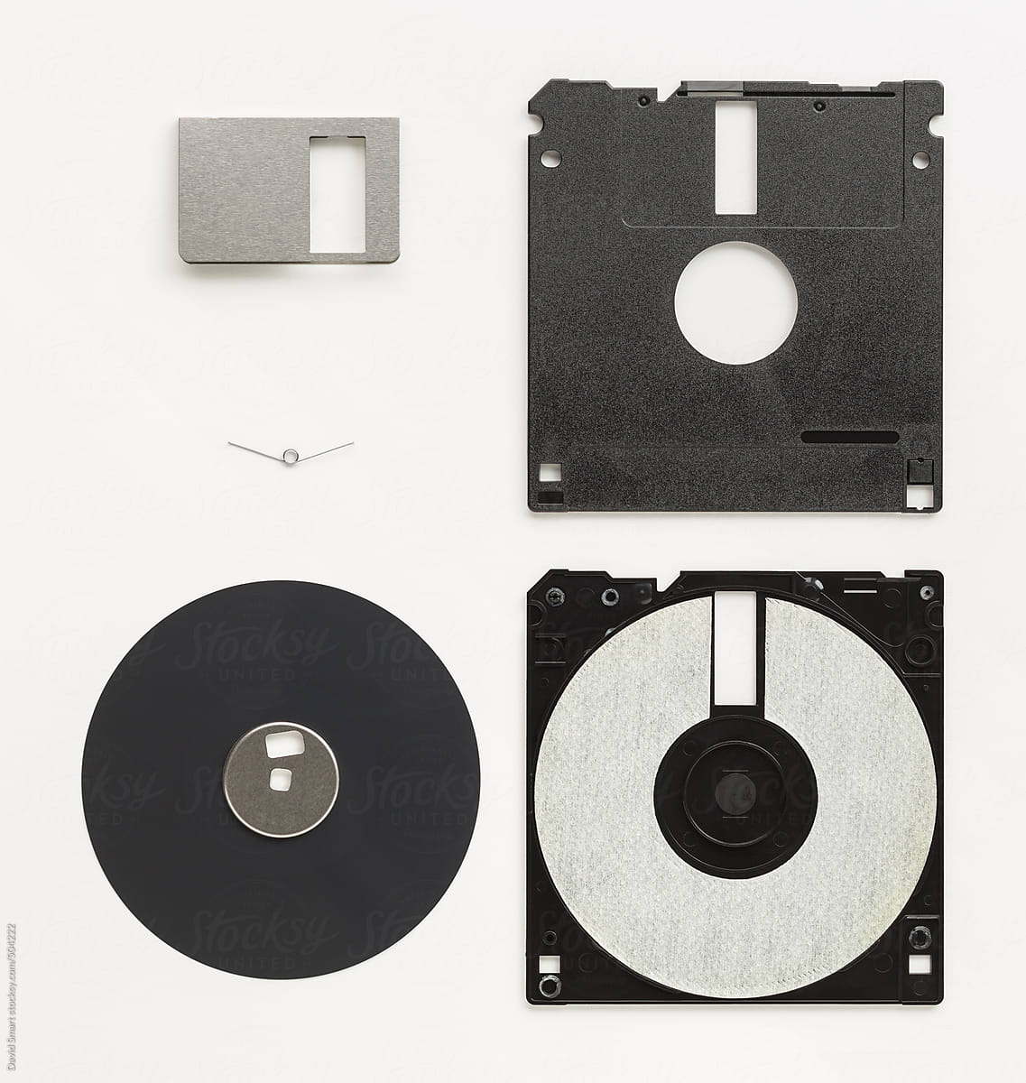 Deconstructed 3.5-inch floppy disk by David Smart - Stocksy United
