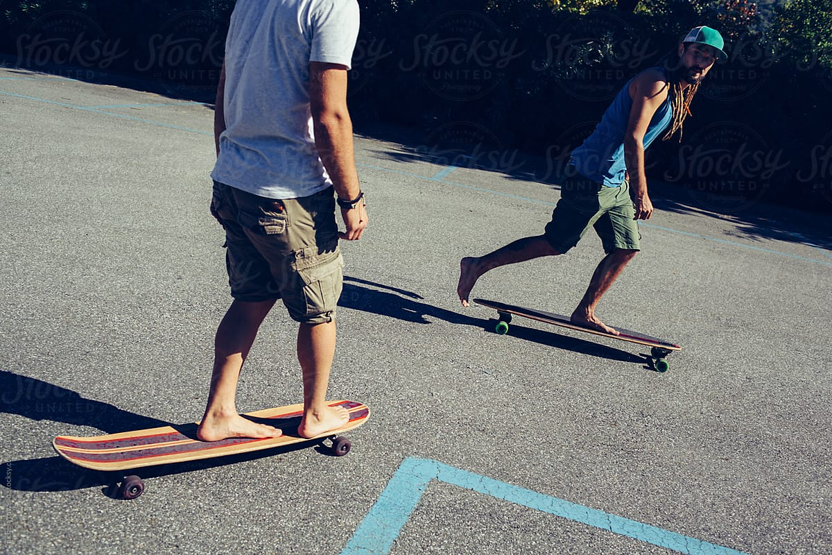 stock photo barefoot skateboarding