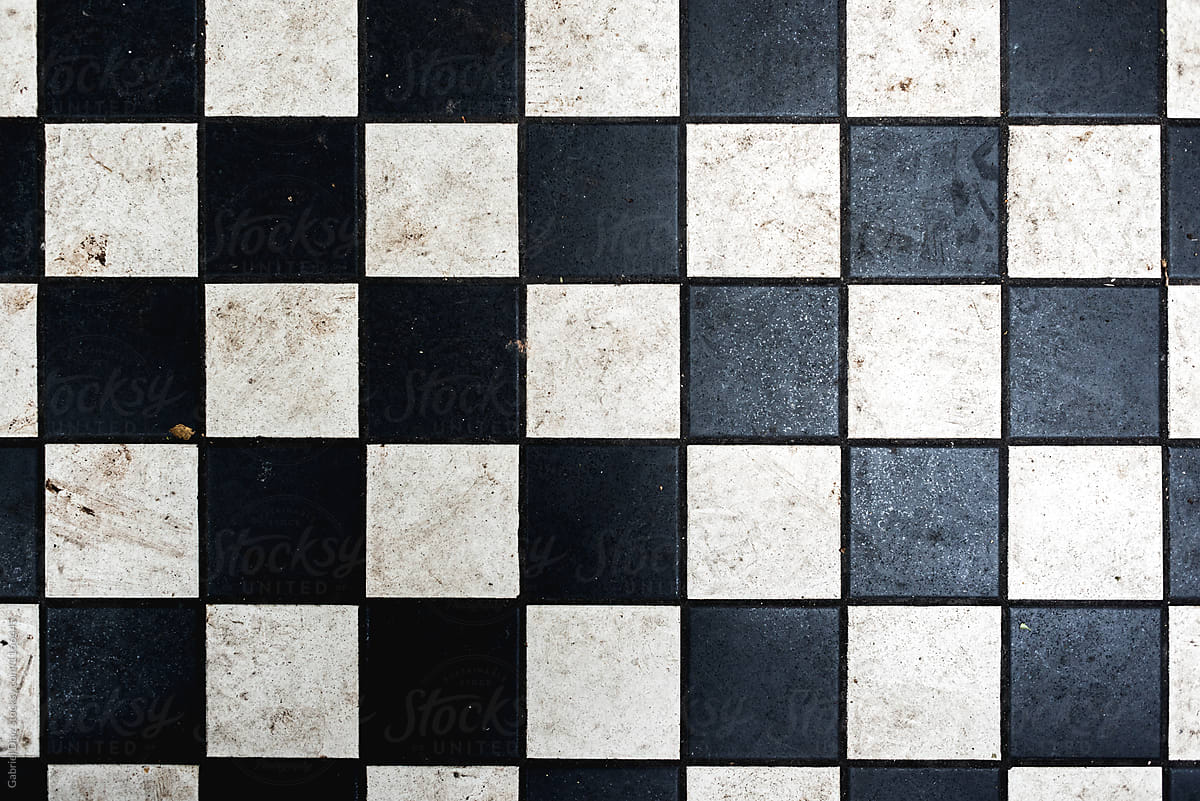 checkered tiles seamless with black and white marble effect by gabriel diaz for stocksy united