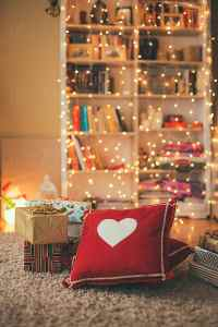 Living room decorated with christmas lights and presents ...