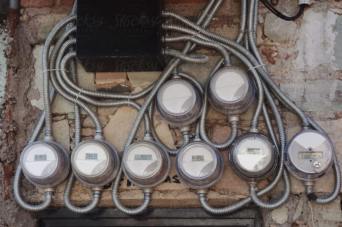 hight resolution of crazy wiring of electrical devices mounted on wall by per swantesson for stocksy united