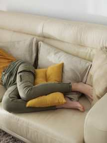 Crop Barefoot Woman Sleeping Sofa Stocksy United