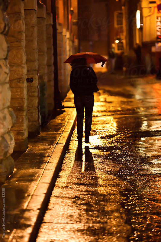 Girl Walking Alone Hd Wallpapers A Silhouette Of A Woman Walking In The Rain At Night In