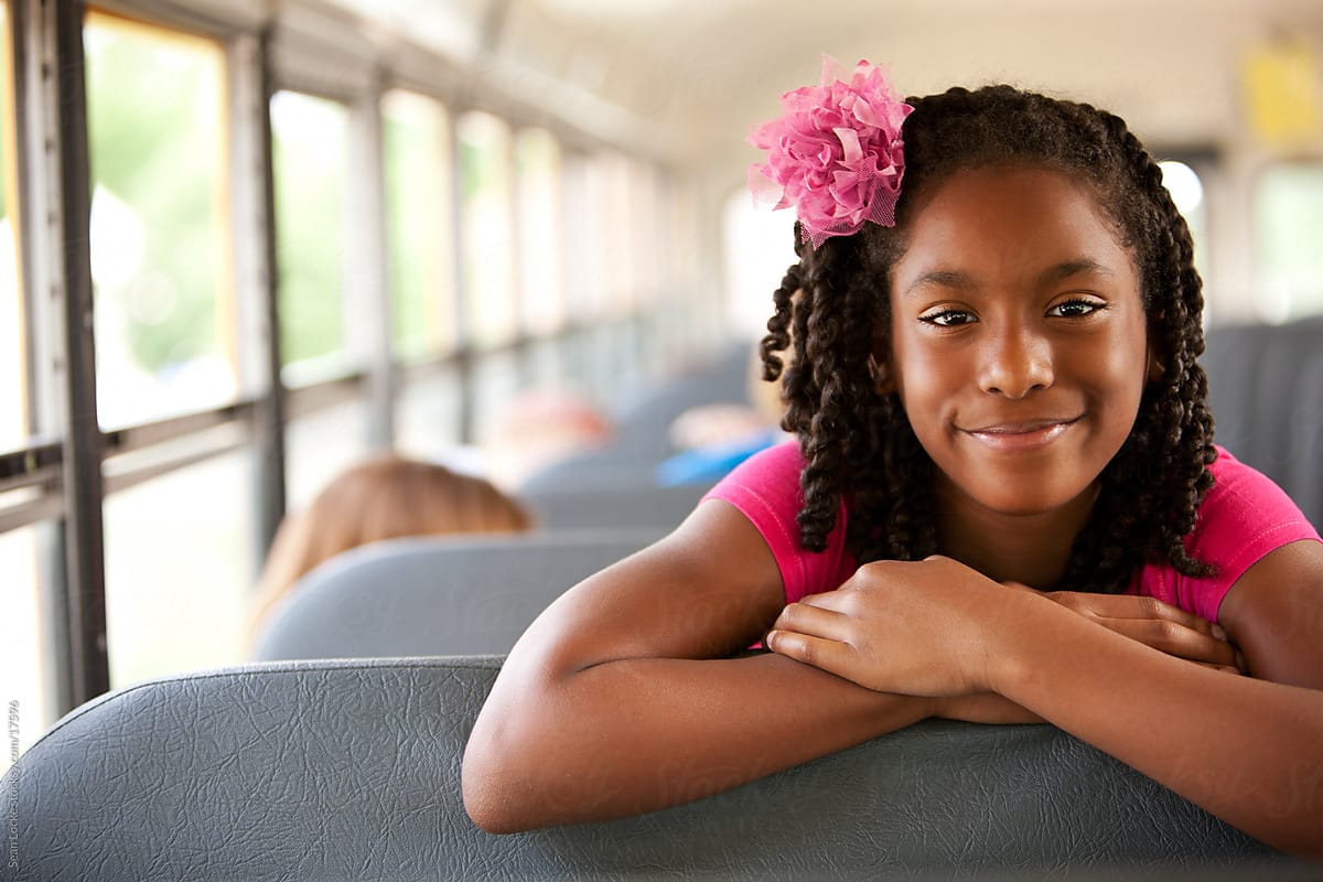 School Bus Cute African American Girl Looks Over Seat By