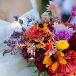 Bride Holding Colorful Wildflower Bouquet By Leah Flores Bouquet Bride Stocksy United
