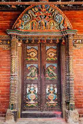 Intricately carved wooden doors in a temple in Kathmandu, Nepal ...