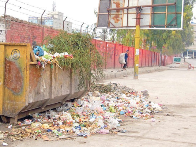 Garbage piles up in dumpsters in localities including, Lyari, Keamari, SITE, New Karachi, Landhi, Korangi, and Surjani where DMC has left it uncollected. PHOTO: FILE