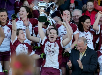 An elated McLaughlin and her team-mates with the trophy.